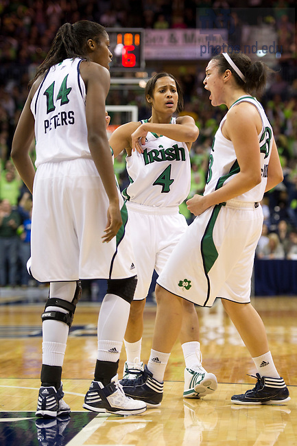 January 7, 2012; Notre Dame Fighting Irish guard Kayla McBride, right, celebrates with forward Devereaux Peters and guard Skylar Diggins after scoring against the Connecticut Huskies in overtime at the Purcell Pavilion. Notre Dame won 75 to 67 in overtime. Photo by Barbara Johnston/University of Notre Dame