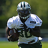 Romar Morris #30 of the New York Jets runs with the ball during the second day of team training camp held at Atlantic Health Jets Training Center in Florham Park, NJ on Sunday, July 30, 2017.