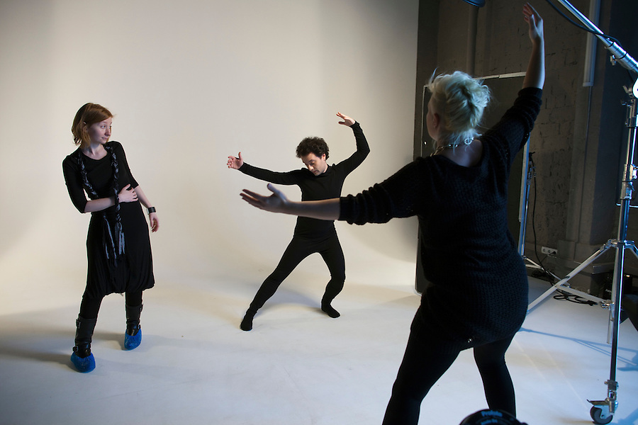 Moscow, Russia, 11/02/2011..Producer Elena Kashirskaya and photographer direct Snob magazine journalist Ilya Kolmonovski during studio shoot in which Kolmonovski enacts parts of the human body.