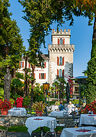 Switzerland, Ticino, Ascona at Lago Maggiore: cafe Castello at the seaside promenade Piazza Giuseppe Motta | Schweiz, Tessin, Ascona am Lago Maggiore: Café Castello an der Promenade Piazza Giuseppe Motta mit Park und direkt am See gelegen