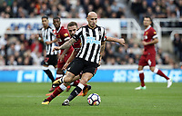 Newcastle United's Jonjo Shelvey under pressure from Liverpool's Jordan Henderson<br /> <br /> Photographer Rich Linley/CameraSport<br /> <br /> The Premier League -  Newcastle United v Liverpool - Sunday 1st October 2017 - St James' Park - Newcastle<br /> <br /> World Copyright &copy; 2017 CameraSport. All rights reserved. 43 Linden Ave. Countesthorpe. Leicester. England. LE8 5PG - Tel: +44 (0) 116 277 4147 - admin@camerasport.com - www.camerasport.com