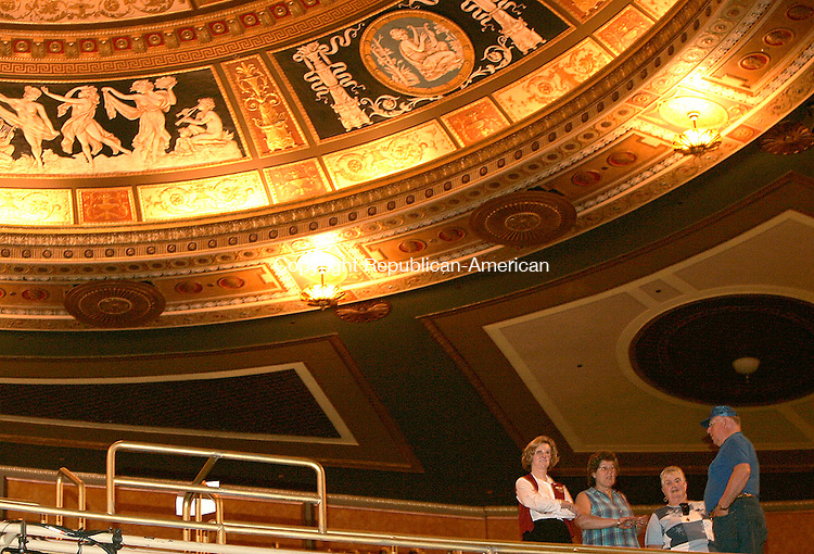WATERBURY, CT - 11 JUNE 2005 -061105JS08--Palace Theater volunteer Liz Caisse, left, gives a tour of the theater to Karen Napoli, also a volunteer usher, and Pat and Richard Weigel of California during an open house on Saturday. The event was part Connecticut Open House Day sponsored by the Connecticut Commission on Culture and Tourism. More than 100 culturial and tourism properties throughout the state participated in the event.   --Jim Shannon Photo-- Liz Caisse; Karen Napoli, Richard Weigel , Pat Weigel, Watebury, Palace Theater are CQ