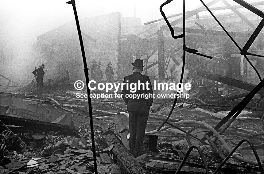 A disconsolate proprietor of one the retail units surveys the devastation following a blaze at Smithfield Market, Belfast, N Ireland, UK, May 1974. The fire wiped out the complete market197405000248d<br /> <br /> Copyright Image from Victor Patterson, 54 Dorchester Park, Belfast, UK, BT9 6RJ<br /> <br /> Tel: +44 28 9066 1296<br /> Mob: +44 7802 353836<br /> Voicemail +44 20 8816 7153<br /> Email: victorpatterson@me.com<br /> Email: victorpatterson@gmail.com<br /> <br /> IMPORTANT: My Terms and Conditions of Business are at www.victorpatterson.com