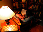 Young girl; reading book; library; pre teen; teenager; relaxed; comfortable