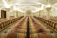 Chateau St Martin de la Garrigue. Languedoc. Barrel cellar. Illuminated cellar. Spectacular vaulted barrel cellar. France. Europe.