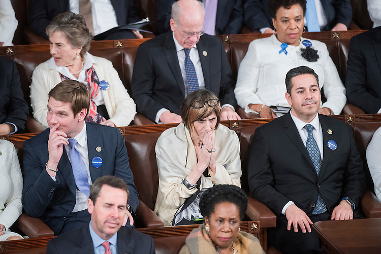 UNITED STATES - FEBRUARY 28: Center row from left, Reps. Eric Swalwell, D-Calif., Rosa DeLauro, D-Conn., and Ben Ray Luján, D-N.M., listen to President Donald Trump address a joint session of Congress in the Capitol's House Chamber, February 28, 2017. Rep. (Photo By Tom Williams/CQ Roll Call)