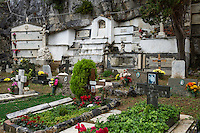 Fresh flowers adorn graves and burial vaults of the village cemetery, Porto Venere, Italy