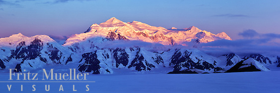 Alpenglow creeps down the face of Mount Logan, Kluane National Park