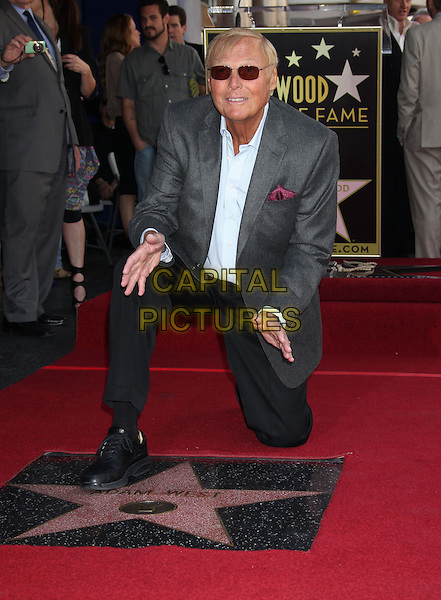 Adam West.Adam West honored with star on the Hollywood Walk of Fame, Hollywood, California, USA..April 5th, 2012.full length grey gray suit jacket blue shirt sunglasses shades black trousers kneeling hands.CAP/ADM/RE.©Russ Elliot/AdMedia/Capital Pictures.