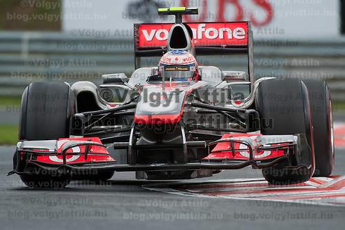 McLaren Formula One driver Jenson Button of Britain drives his car during Hungarian F1 Grand Prix in Mogyorod (about 20km north-east from Budapest), Hungary. Sunday, 31. July 2011. ATTILA VOLGYI
