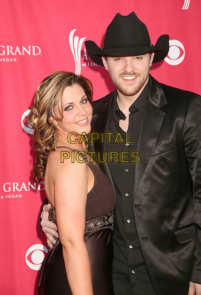 ADRIANNE LEON & CHRIS YOUNG.42nd Annual Academy Of Country Music Awards held at the MGM Grand Garden Arena, Las Vegas, Nevada, USA..May 15th, 2007.half length brown dress satin black suit jacket stetson hat .CAP/ADM/BP.©Byron Purvis/AdMedia/Capital Pictures