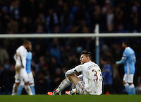 Federico Fernandez of Swansea City looks dejected at the end of the game during the Barclays Premier League match between Manchester City and Swansea City played at the Etihad Stadium, Manchester on December 12th 2015