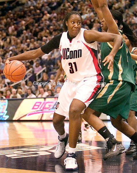 HARTFORD, CT. 04 March 2007-030407SV05--#31 Tina Charles of UConn drives to the hooop as #32 Nalini Miller of South Florida defends during Big East basketball tournament action at the Hartford Civic Center in Hartford Sunday.<br /> Steven Valenti Republican-American