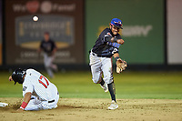 Missoula Osprey shortstop Jose Reyes (20) throws to first base while avoiding a slide by Harvin Mendoza (17) during a Pioneer League game against the Great Falls Voyagers at Centene Stadium at Legion Park on August 19, 2019 in Great Falls, Montana. Missoula defeated Great Falls 1-0 in the second game of a doubleheader. (Zachary Lucy/Four Seam Images)
