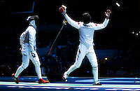 31 JUL 2012 - LONDON, GBR - Ma Jianfei (CHN) (right) of China celebrates a point in his round of 32 men's individual foil match against Daniel Gomez (MEX) of Mexico at the ExCel Exhibition Centre in London Docklands, London, Great Britain .(PHOTO (C) 2012 NIGEL FARROW)