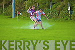 Kevin Dwyer of Waterville & Eoin Leary of Na Piarsaigh battle it out in the puddles in the Dromid GAA grounds.