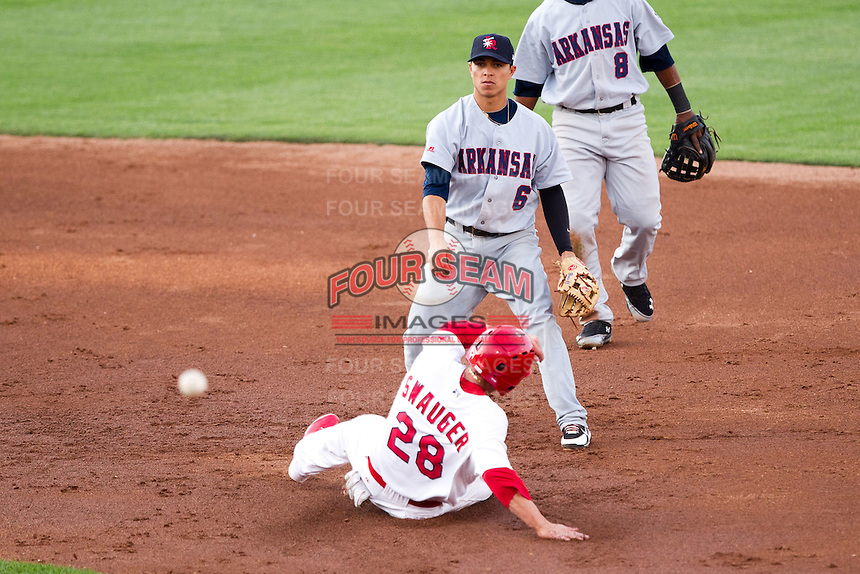 Darwin Perez (6) of the Arkansas Travelers turns a double play during a game against the Springfield Cardinals at Hammons Field on June 13, 2012 in Springfield, Missouri. (David Welker/Four Seam Images)