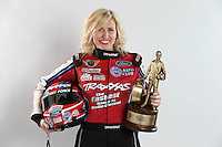 Feb. 22, 2013; Chandler, AZ, USA; NHRA funny car driver Courtney Force poses for a portrait with a Wally trophy prior to qualifying for the Arizona Nationals at Firebird International Raceway. Mandatory Credit: Mark J. Rebilas-