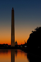View of Washington Monument and Reflecting Pool with Capitol Hill in Background at Sunrise.