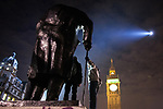© Joel Goodman - 07973 332324 . 09/12/2010 . London , UK . Two men climb on the statue of Winston Churchill in Parliament Square . Students and their supporters clash with police during a demonstration in Parliament Square in London against government cuts to student support , Educational Maintenance Allowance ( EMA ) and rising university tuition fees . Photo credit : Joel Goodman