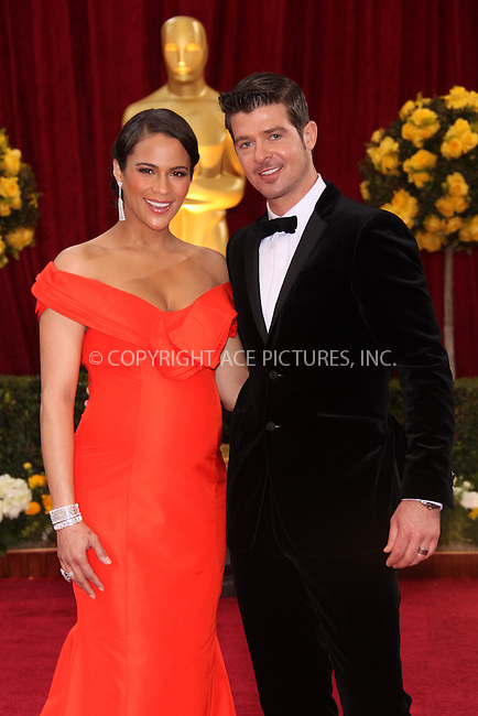 WWW.ACEPIXS.COM . . . . .  ....March 7 2010, Hollywood, CA....Actress Paula Patton and husband singer Robin Thicke arriving at the 82nd Annual Academy Awards held at Kodak Theatre on March 7, 2010 in Hollywood, California.....Please byline: Z10-ACE PICTURES... . . . .  ....Ace Pictures, Inc:  ..Tel: (212) 243-8787..e-mail: info@acepixs.com..web: http://www.acepixs.com