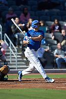 Matt Mervis (20) of the Duke Blue Devils follows through on his swing against the Coastal Carolina Chanticleers at Segra Stadium on November 2, 2019 in Fayetteville, North Carolina. (Brian Westerholt/Four Seam Images)