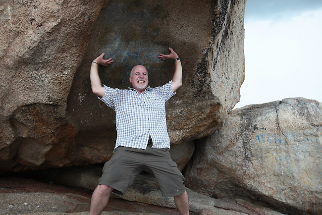 """If I don't hold up this rock, it will crush me.""  Nha Trang, Vietnam. July 14, 2011. Photo by Thuy Tram Le."