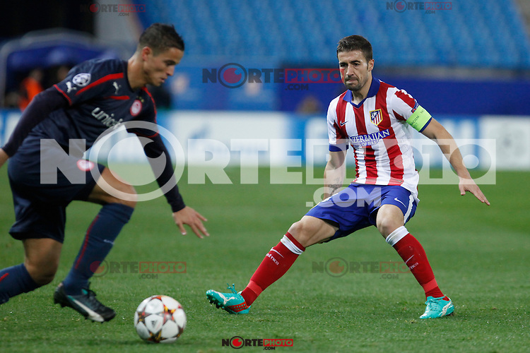 Atletico de Madrid´s Gabi (R) and Olympiacos´s Afellay during Champions League soccer match between Atletico de Madrid and Olympiacos at Vicente Calderon stadium in Madrid, Spain. November 26, 2014. (ALTERPHOTOS/Victor Blanco) /NortePhoto