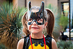 27 MAY 2011 - PHOENIX, AZ: A child dressed as Batgirl at Phoenix Comicon Friday. Phoenix Comicon opened Thursday and featured a Zombie Walk through downtown Phoenix Friday night. Hundreds of people participated in the Zombie Walk, both as Zombies and as Zombie hunters. This year's Comicon includes appearances by Leonard Nimoy (Star Trek), Adam Baldwin (Firefly and Chuck), Stan Lee (Marvel Comics), Nicholas Brendon (Buffy the Vampire Slayer) and others. Activities include costuming workshops, role playing games and a Geek Prom.     Photo by Jack Kurtz
