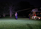US President Donald J. Trump disembarks Marine One upon returning to the White House in Washington, DC, USA, 24 October 2018. Trump was returning from a campaign rally in Wisconsin.<br /> Credit: Erik S. Lesser / Pool via CNP