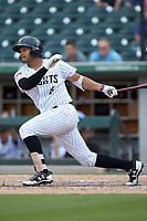 Jose Rondon (6) of the Charlotte Knights follows through on his swing against the Indianapolis Indians at BB&T BallPark on August 22, 2018 in Charlotte, North Carolina.  The Indians defeated the Knights 6-4 in 11 innings.  (Brian Westerholt/Four Seam Images)