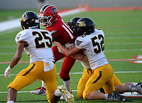 NWA Democrat-Gazette/ANDY SHUPE<br /> Farmington quarterback Marqwaveon Watson (10) is taken down Friday, Sept. 6, 2019, by Prairie Grove linebacker Carter Scates (52) and cornerback Cordelle Whetsell during the first half of play at Cardinal Stadium in Farmington. Visit nwadg.com/photos to see more photographs from the game.