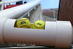 RALEIGH, NC - MAY 07: A pair of softballs sit in the ball return chute, which fans use to return foul balls to the dugout. The North Carolina State University Wolfpack hosted the University of Louisville Cardinals on May 7, 2017, at Dail Softball Stadium in Raleigh, NC in a Division I College Softball game. Louisville won the game 7-0.