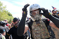 PORTLAND, OR - AUGUST 04: A member of a far-right group dons protective gear during a rally for gun rights' laws and free speech on August 4, 2018 at Tom McCall Waterfront Parkin in Portland, Oregon. (Photo by Karen Ducey/Getty Images)