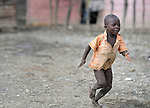 A boy runs in Batey Bombita, a community in the southwest of the Dominican Republic whose population is composed of Haitian immigrants and their descendents.