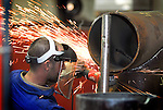 A NuWeld welder works on a seam on a pipe for the gas industry at the Trout Run facility on Friday March 18, 2011