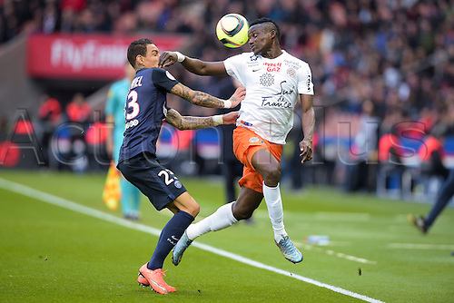 05.03.2016. Paris, France. French League 1 football. Paris St Germain versus Montpellier.  Gregory van der Wiel (PSG) challenged NINGA Casimir (Montpellier) for the high ball