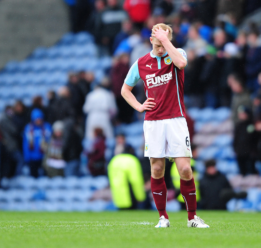 Burnley's Ben Mee looks dejected at the final whistle<br /> <br /> Photographer Chris Vaughan/CameraSport<br /> <br /> Football - Barclays Premiership - Burnley v Leicester City - Saturday 25th April 2015 - Turf Moor - Burnley<br /> <br /> &copy; CameraSport - 43 Linden Ave. Countesthorpe. Leicester. England. LE8 5PG - Tel: +44 (0) 116 277 4147 - admin@camerasport.com - www.camerasport.com