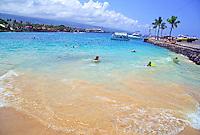 Kids body boarding at the small beach area in Kailua-Kona town on the Big Island
