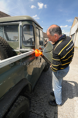 1978 Land Rover 100in V8 Swiss Army Prototype - BAC 779T - getting fueled up by David Pile for the Dunsfold Collection weekend. Dunsfold Collection of Land Rovers 2011, Dunsfold, Surrey, UK. --- No releases available, but releases may not be necessary for certain uses. Automotive trademarks are the property of the trademark holder, authorization may be needed for some uses. --- Vehicle Information: Vehicle belongs to the Dunsfold Collection of Land Rovers: Chassis number 100S2M04X, registration number BAC 779T, engine type 3.5 V8 petrol 24V, gearbox type 4-speed. --- Vehicle History: This is one of a round 25 100in prototypes for the Swiss and French Army in 1978. Originally built as LHD, BAC was converted to RHD in the early eighties. A 24 Volt screened electrical system is used. There were quite a few body styles made, including Hard Top, Soft Top. and Station Wagon. The chassis were a one of for these vehicles, the axles were Range Rover, as were the engine and gearbox, some were fitted with automatic gearboxes and 2.25 petrol engines.The 100 inch wheelbase has inspired many enthusiasts to take an old Range Rover chassis and fit a Land Rover style body.