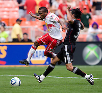 Juan Manuel Pena (3) of D.C. United tries to stop Dane Richards (19) of the New York Red Bulls at RFK Stadium in Washington, DC.  The New York Red Bulls defeated D.CC United, 2-0.