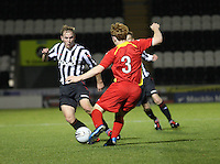 Graemem McGregor and Jack Bruce (3) tackle in the St Mirren v Dunfermline Athletic Clydesdale Bank Scottish Premier League U20 match played at St Mirren Park, Paisley on 2.10.12...