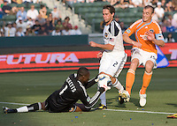 LA Galaxy goalkeeper Donovan Ricketts (1) makes a diving save teammate defender Todd Dunivant (2) blocks advancing Houston Dynamo forward Cam Weaver (15). The LA Galaxy defeated the Houston Dynamo 4-1 at Home Depot Center stadium in Carson, California on Saturday evening June 5, 2010..