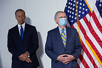 United States Senate Majority Leader Mitch McConnell (Republican of Kentucky), right, and United States Senator John Thune (Republican of South Dakota) listen during a news conference following GOP policy luncheons on Capitol Hill in Washington D.C., U.S., on Tuesday, June 9, 2020.  Credit: Stefani Reynolds / CNP/AdMedia