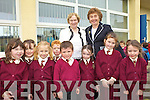 FAREWELL: Some of the pupils of St Joseph's School in Ballybunion saying farewell to their principal, Joan Lyons (left), who retired on Friday, with the incoming principal, Carmel Guiney.