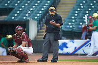 Home plate umpire Olindo Mattia checks his indicator during the game between the Florida State Seminoles against the Notre Dame Fighting Irish in Game Four of the 2017 ACC Baseball Championship at Louisville Slugger Field on May 24, 2017 in Louisville, Kentucky. The Seminoles walked-off the Fighting Irish 5-3 in 12 innings. (Brian Westerholt/Four Seam Images)