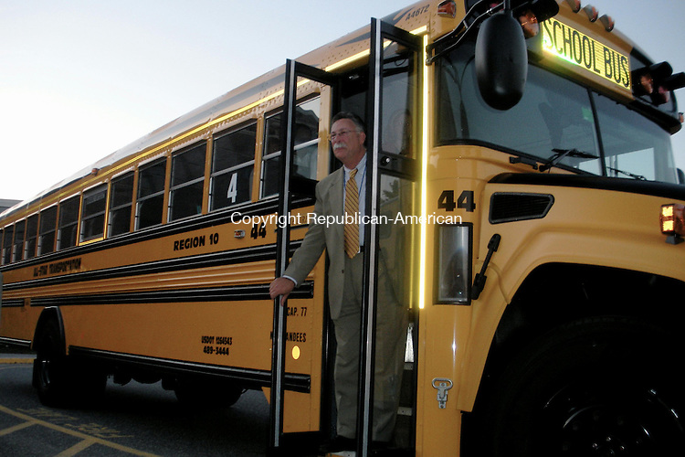 HARWINTON, CT -- 091409KB01 -- 14 September 2009 -- Region 10 Superintendent of Schools Alan Beitman checks out one of the district's 10 new buses at a Board of Education meeting at Har-Bur Middle School in Burlington on Monday. The buses, which cost the local bus company, All-Star Transportation, more than $800,000, are state-of-the-art 2010 Blue Bird Vision models designed for better driver visibility. All-Star, which has more than 500 school vehicles in service daily across Litchfield County, allocated the new buses to Harwinton because the company's owner, Leslie Sheldon, lives there and wanted to give back to her hometown, she said at the meeting on Monday. Kari Banach Photo