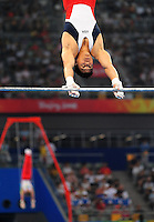 Aug. 9, 2008; Beijing, CHINA; Kai Wen Tan (USA) performs on the horizontal bar during mens gymnastics qualification during the Olympics at the National Indoor Stadium. Mandatory Credit: Mark J. Rebilas-