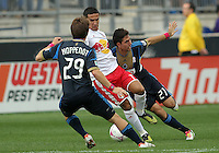 CHESTER, PA - OCTOBER 27, 2012:  Michael Farfan (21) and Antoine Hoppenot (29) of the Philadelphia Union surround  Tim Cahill (17) of the New York Red Bulls during an MLS match at PPL Park in Chester, PA. on October 27. Red Bulls won 3-0.