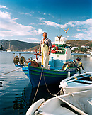 GREECE, Patmos, Grikos, Dodecanese Island, Sozos docking his boat called the Atios Minas-Raina in the port of Grikos, the Agean Sea